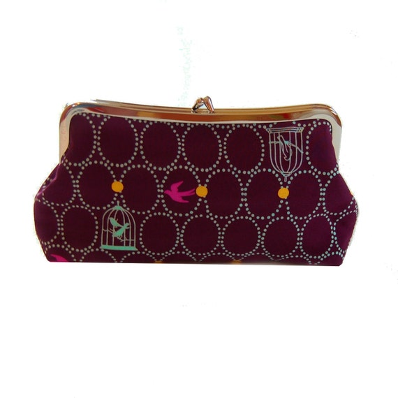 Clutch purse with birdcages on purple