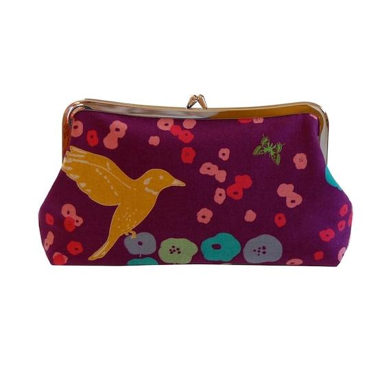 Clutch purse with yellow bird on purple