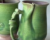 Pair green curly mugs