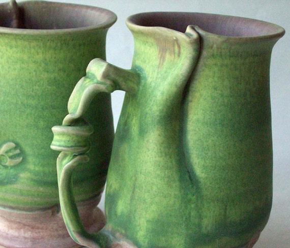 Pair green curly mugs 64
