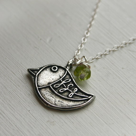 Bird necklace with peridot bead accent