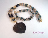 blue gold and bronze leaf necklace and matching bracelet