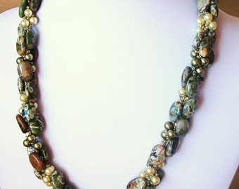 Rhyolite and green pearl spiral necklace