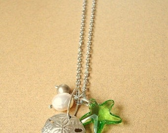 argentium silver .935 sand dollar and pearl necklace on rhodium plated silver chain