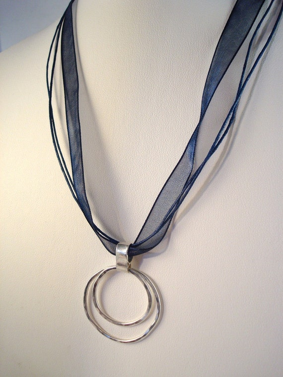 double circle argentium sterling silver 930 hammered organic  pendant on blue ribbon