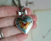 butterfly heart. locket necklace. orange and blue