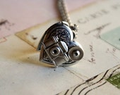loves photography. camera locket necklace