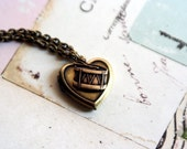 loves the drum. locket necklace. brass ox color