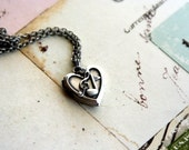 music notes heart locket necklace. silver ox