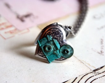 loves photography. camera locket necklace. patina and silver ox
