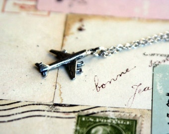 in flight. airplane necklace. pewter