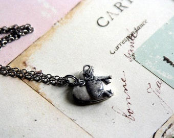 elephant. heart locket necklace. silver ox