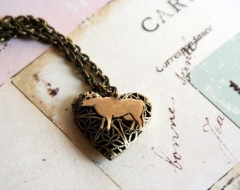 loves cows. locket necklace. brass ox
