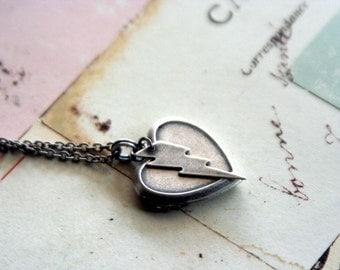 lightning bolt. locket necklace. silver ox