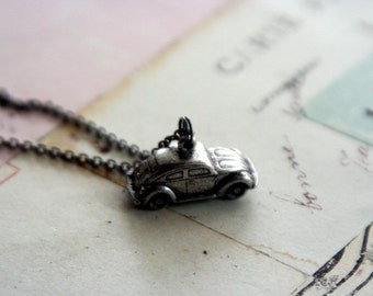 the beetle bug car. necklace. silver ox