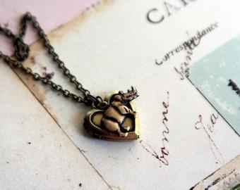 rhino. heart locket necklace. brass ox
