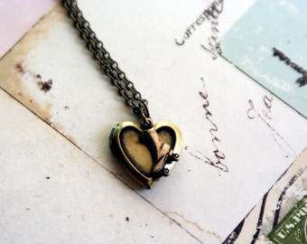 roller skate. locket necklace. brass ox