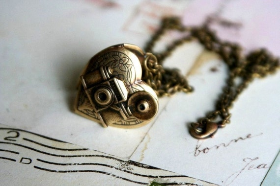 loves photography. camera necklace. brass ox
