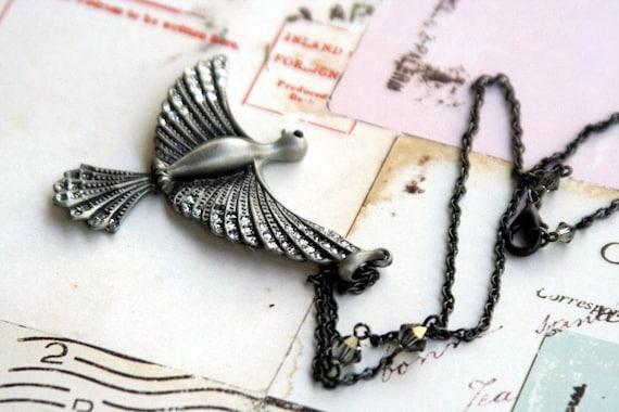 flying bird. grey pendant necklace