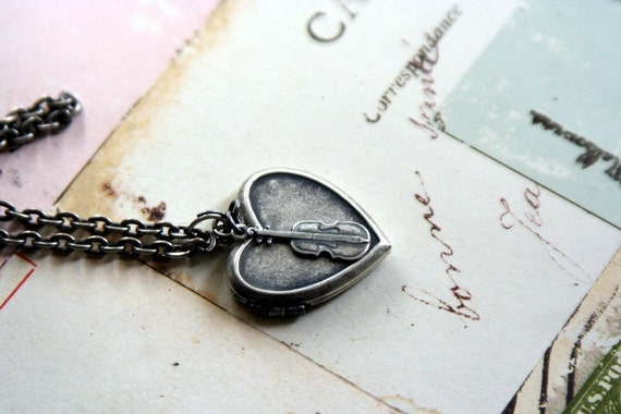 loves the violin. locket necklace.silver ox color