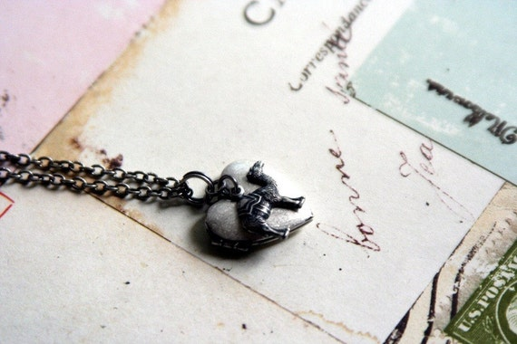 camel. heart locket necklace. silver ox