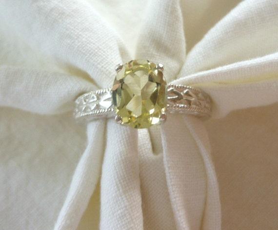 9MM X 7MM oval cut 1.55 ct lemon quartz sterling silver ring size 7