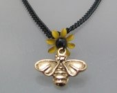 Summer Breeze. A brass bee and vintage, enameled, yellow, daisy, flower, necklace.