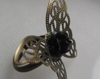 Signs of Life  (a brass butterfly and black rose ring)
