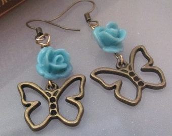 Coming Up (teal blue rose and brass butterfly earrings)