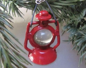 Let there be more light, a miniature, red, lantern, mini,camping, nature, mountain, necklace.