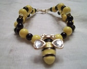 Xicohtencatl Collection Bracelet Black Yellow Beads Red Ribbon Winner