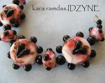 Bumpy Black Hearts on Blushing Tangerine Tabs Set of 7 Lampwork Beads