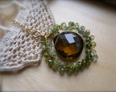 Green Tourmaline Wrapped Pendant in Gold