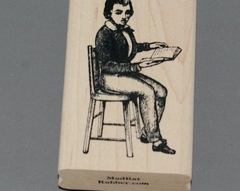 Boy Reading in Chair Wood Mounted Rubber Stamp