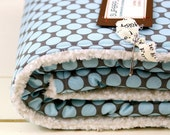 baby blanket, blue and grey polkadot, classic and modern, parent-friendly.