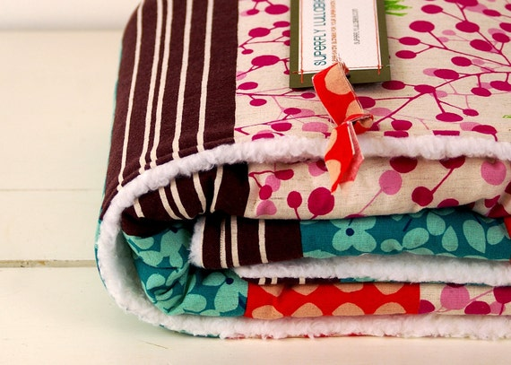 baby blanket, modern japanese eclectic design, parent-friendly.