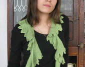 Seaweed Scarf, short rows create a spiral shaped scarf, knit in garter stitch. PDF knitting pattern