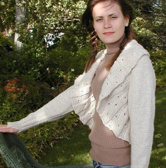 Ruffled Cardigan, knitted from the top down this raglan sleeve sweater has flattering details.   PDF knitting pattern
