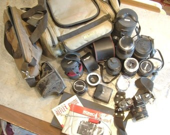 Konica Autoreflex TC 35 mm camera body plus several assorted lenses and cases vintage kit