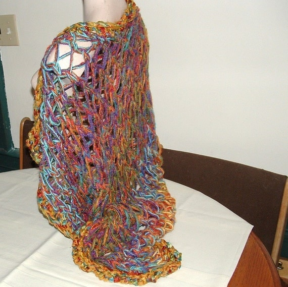Shawl of many colours in jumbo lacy knit stitch with crocheted edge handmade