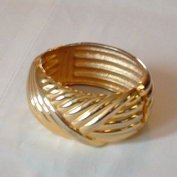 Faux gold cuff style bracelet bangle with spring opening shiny goldtone vintage