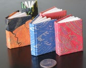 set of five miniature books