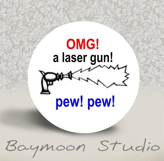 omg a Laser Gun Pew Pew - PINBACK BUTTON or MAGNET - 1.25 inch round