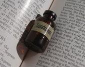 Laudanum miniature glass bottle pendant charm