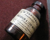 Reproduction vintage laudanum and lead water miniature glass poison bottle charm