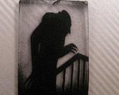 Vintage Nosferatu silent film still shadow image charm