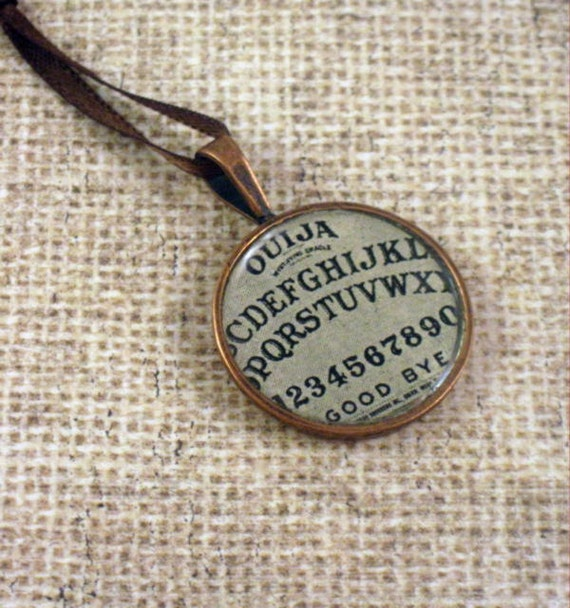 Vintage Oujia board aged copper bezel and resin pendant