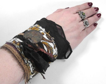 Steampunk Cuff, Victorian Inspired GOLD BLACK Brocade Wrist Cuff, Vintage Ribbons Buttons, Brass Tag MORE- Steampunk Clothing by edmdesigns