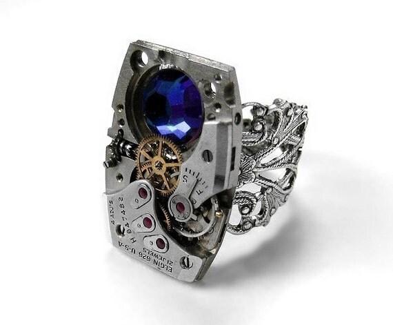 Steampunk Ring - VINTAGE ELGIN RECTANGULAR Watch Movement RUBY Jeweled Adjustable Filigree Ring with Meridian Blue Swarovski Crystal -- GORGEOUS