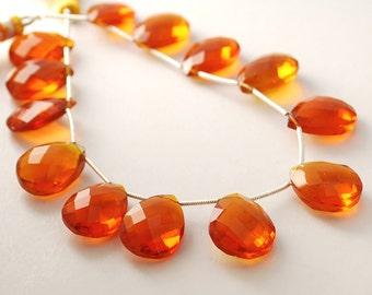 1/2 strand- Orange quartz faceted pear briolettes